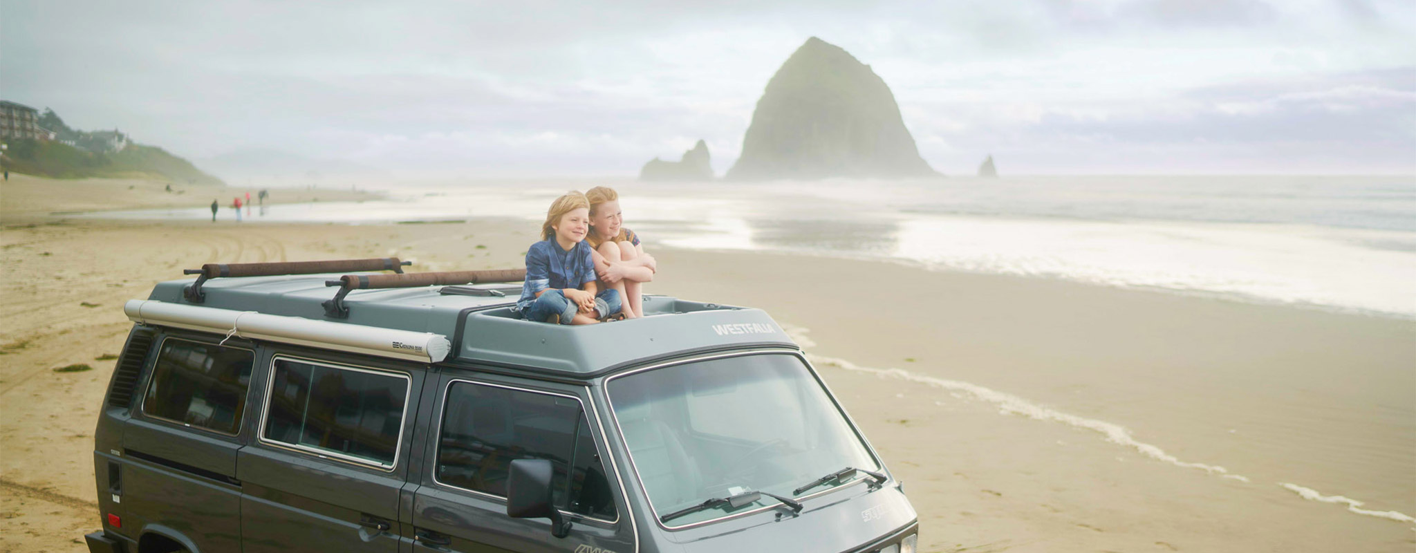 van in Cannon Beach with haystack rock in background