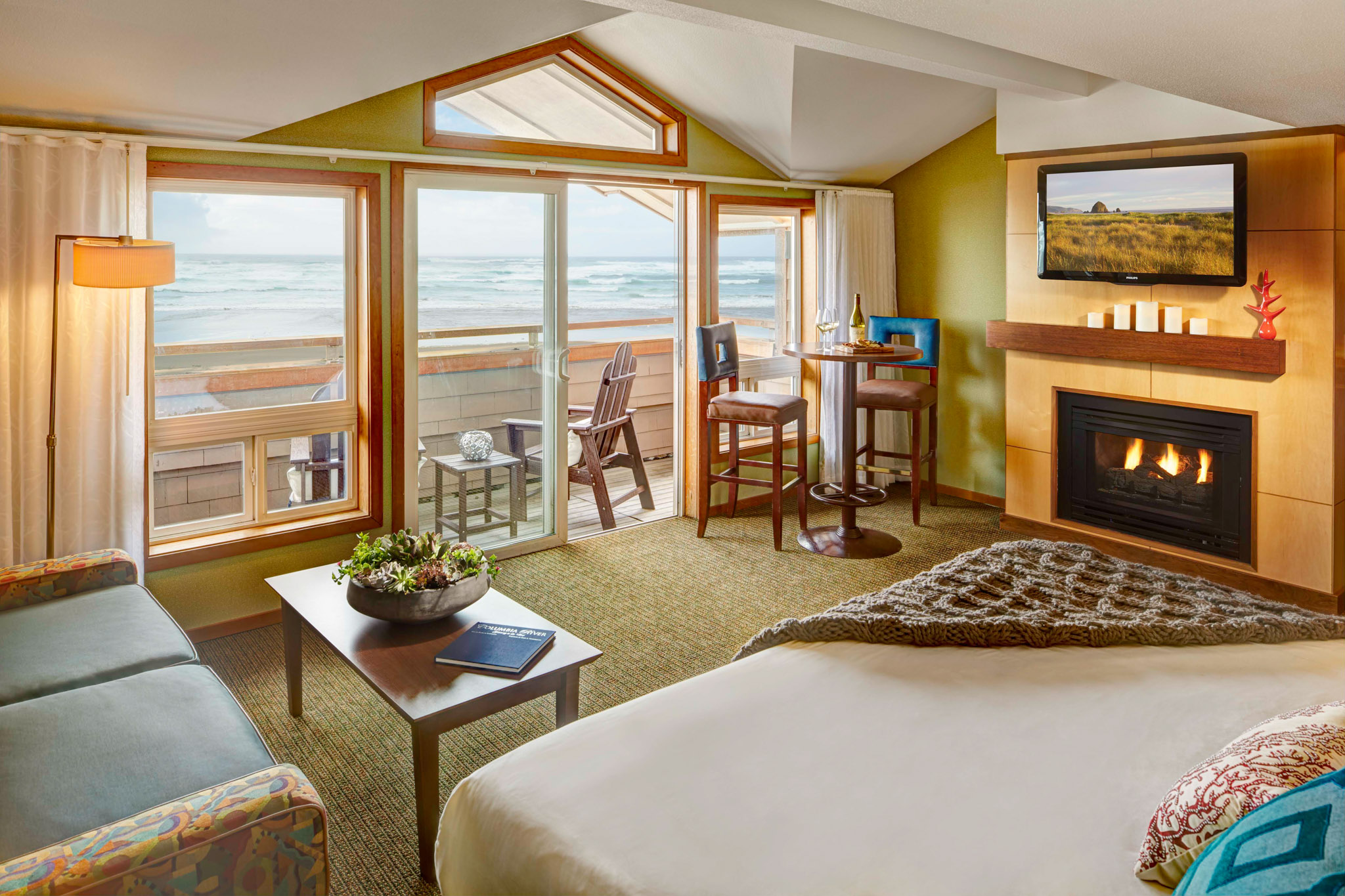 beachfront king studio hotel room looking out at the ocean