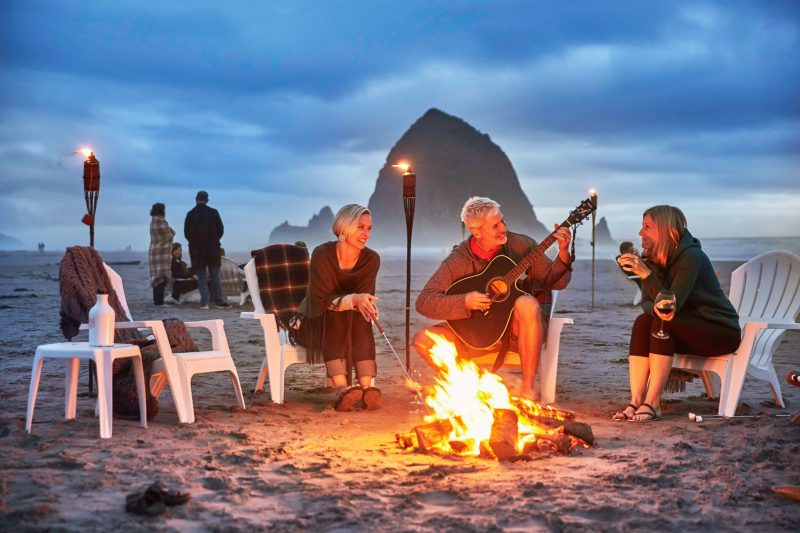 Family bonfire on the beach